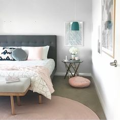 Our grey velvet round cushion sitting pretty in the home of @designdevotee
