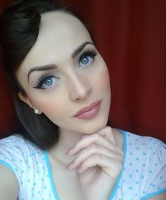 Check out this #BlueEyes pin up eye makeup look. Note her #FalseEyelashes and black eyeliner only on the outer half of the bottom lash line to open up the eyes.