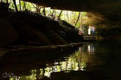 Riviera Maya trash the dress photography in a sacred cenote in the Yucatan Peninsula. Mexico wedding photographers Del Sol Photography.
