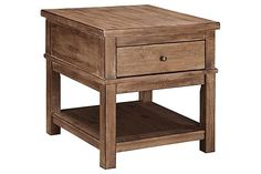 "The Pinnadel End Table from Ashley Furniture HomeStore (AFHS.com). With a vintage wire brushed gray-brown color finish beautifully covering the thick look of this rustic collection, the ""Pinnadel"" accent table collection provides a relaxing Vintage Casual design while adding the function of a lift-top cocktail table and a USB charging dock within the end table drawer."