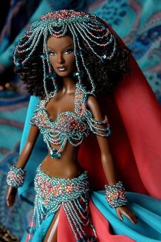 Изображение Top Model Nikki doll, wearing beaded outfit.