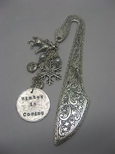 Billy or Danielle $18  Game of Thrones - Winter is Coming - House Stark  Handstamped Beaded Charm Bookmark. $18.00, via Etsy.