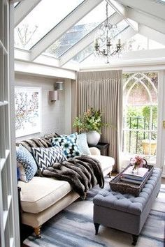 darling tiny living room in a conservatory!  This space would make rainy days feel happier!