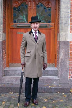 The Covert coat though originally created for hunting and riding also does well over a navy three-piece suit in the city
