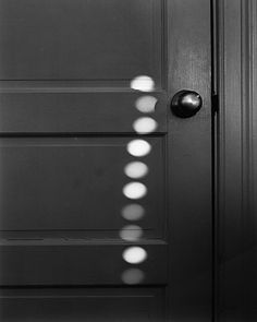 Abelardo Morell :: Ten Sunspots on My Door