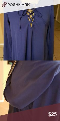 New long sleeve top New Blue lace up top. Nice material. Has,a hood . Not form fitting. Size m Tops Blouses