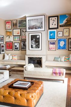 An eclectic and well-varied gallery wall adds colorful depth to a sleek, contemporary neutral space. Plus, a gallery wall is the perfect place to incorporate kid's artwork.