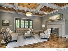 While it isn't horrible, I'm just so very sick of seeing these many contemporary grey/greige monochromatic rooms.  ESPECIALLY when they're done in beautiful older traditional homes (ie: this is in a 1920's Tudor home).  I just can't stand it.  :)  -db.