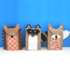 Turn simple brown paper lunch bags into adorable woodland creature gift bags...a hedgehog, a raccoon, and a fox