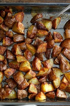 NYT Cooking: These potatoes are beloved by children and adults alike, and they are very easy to make. Just cube the potatoes (don't bother to peel) and tumble them into a pan. Pour on the olive oil, sprinkle the oregano, peel the garlic cloves (you don't even have to do that if you're pushed for time), mix everything together and stick the dish in the oven. Serve alongside so...