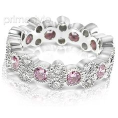 Present yourself with our luxuriant 14KT white gold diamonds and pink sapphires eternity band. Composed with 1.90CT round cut breathtaking diamonds and pink sapphires . This eternity band features exquisite diamonds of G-H color and, VS1-VS2 group clarity. Shine with elegance and simplicity with our 14KT white gold diamonds and pink sapphires eternity band.