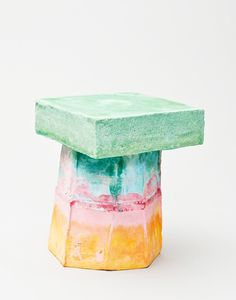 stool made by a pigment colored mixture of sand and mortel. Layer by layer is poured in a casting mould. Than the massive object is worked to a stool by hammer  Every stool is a unique piece. The stools can be kept outside like real stone  Kueng Caputo