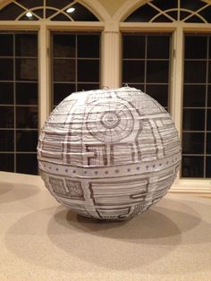 Cheap paper lantern and a sharpie... Death Star