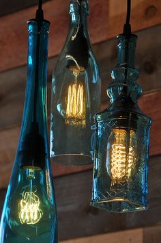Recycled bottle pendant chandelier the harmony 3 light teal recycled glass rustic decor bar lighting unique light fixture Wine Bottle Art, Lighted Wine Bottles, Wine Bottle Crafts, Bottle Candles, Glass Bottles, Wine Bottle Chandelier, Pendant Chandelier, Pendant Lights, Jar Lights