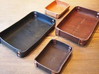 Leather trays in a variety of colors and sizes. Personalized stamping.