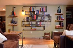 Industrial Pipe Bookshelf As Seen on MAN CAVES. $1,200.00, via Etsy.  Love this!!