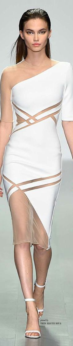 We adore this David Koma white one shouldered gown with cut out mesh panels...x