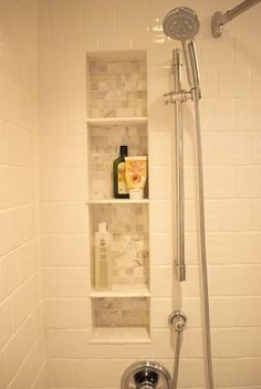 Tile shower shelf, between the studs.  Another pinner said: We did this when we remodeled  it looks so much better than a wire thing hanging on the shower head.