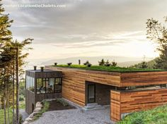 A modern Scandinavian-style chalet with a green roof in Charlevoix, Quebec. #cottagescanada