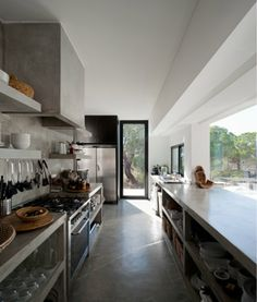 Casa na Comporta-love the open shelving and how it opens to outside