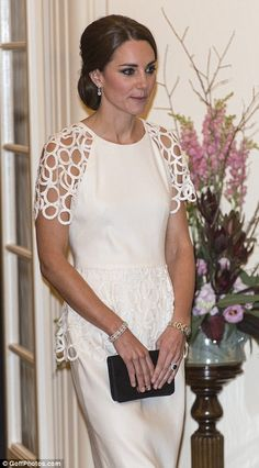 Catherine chose an elegant ivory Lela Rose cocktail dress for the occasion, pairing it with black court heels and diamond drop earrings