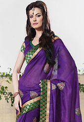 The evolution of style species collection spells pure femininity. This dark purple art silk saree have beautiful embroidery work which is embellished with resham, zari and patch border work. Fabulous designed embroidery gives you an ethnic look and increasing your beauty. Matching blouse is available. Slight Color variations are possible due to differing screen and photograph resolutions.