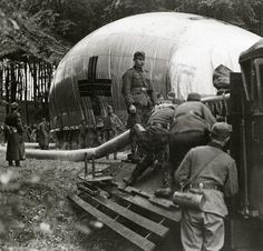 English: Second World War. German soldiers preparing an observation balloon in a forest. Place unknown. 1939.