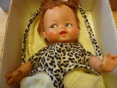 """This is the original 1963 Baby Pebbles from the famous The Flinstones cartoon. She is complete in her box with diaper, blanket and hair bone. She stands approximately 15"""" tall."""