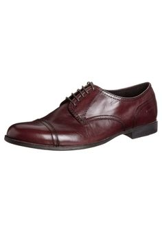 Brown red brogues