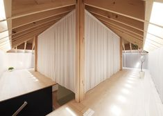 Translucent curtains surround a mezzanine tea room in the heart of this home, designed by Katsutoshi Sasaki + Associates for a retired couple in Japan's Aichi Prefecture