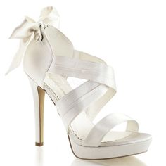 "4 3/4"" Heel, 1"" Platform Criss Cross Closed Back Sandals With Back Bow and Back Zipper."