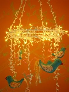 DIY Lighted Baby Mobile: fairy lights entwined with fabric birds, so creative ♥