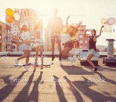 Happy friends jumping from joy on the rooftop royalty-free stock photo
