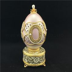 Music box eggshell pink jewelry case This exquisite and romantic Goose Egg Musical Box is delicately hand carved and adorned with faux pearls. It is genuine goose egg shell treated with reinforcement method.