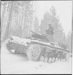 "frau-garlic: "" A Panzer III ausf. D drives along a snowy road in Finland. 5 May 1942. """