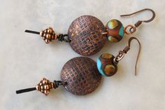 Rustic Etched Discs with Art Bead by ContentsJewelry on Etsy