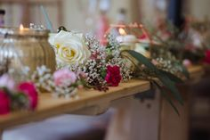 This gorgeous top table arrangement was warm and elegant with metallic copper and gold candle holders and flowers (roses, gysophila, carnations) strewn across the front. Summer wedding decor by Glass Slipper Weddings