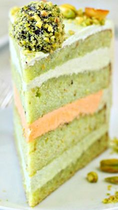Pistachio Orange Cake ~ pistachio cake, pistachio & orange buttercream, and a beautiful pile of pistachio-orange truffles on top! Just Desserts, Delicious Desserts, Dessert Recipes, Awesome Desserts, Awesome Cakes, Merangue Cake, Pistachio Cake, Cake Recipes From Scratch, Orange Buttercream