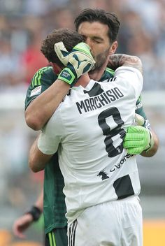 2fe22202d0 Gianluigi Buffon of Juventus FC embraces Claudio Marchisio of Juventus FC  during the serie A match