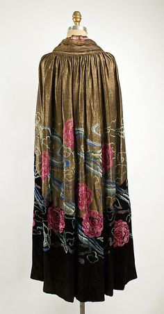 1920 gold shimmering (shantung?) silk evening cape with pink rose floral of glass beads. Photo: The Metropolitan Museum of Art