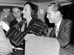 """Joan Crawford and Franchot Tone arrive at the premiere of """"The Bride Wore Red"""", 1937."""