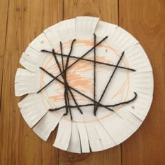 Toddler/Preschooler fine motor activity - snip around edges of a paper plate then thread wool around the plate and secure with the cut edges