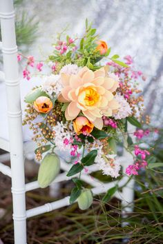 A cascade bouquet made of peach tuips, pink berries, a golden lotus flower ! Glitter Wedding Ideas // Tasha Seccombe Photography
