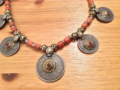 A closer view of the decorated currencies of this necklace ...