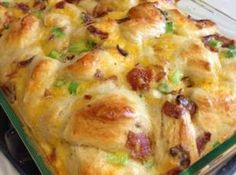 Comfort Breakfast Bake- eggs, biscuits, scallions, extra sharp cheddar bacon &/or sausage.