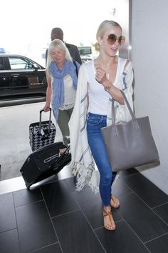 Julianne Hough wearing L'agence Margot High Rise Skinny Jeans in Light Vintage, Chloe Carlina Sunglasses, Frame Le Poncho Fringed Striped Alpaca Cape, K.Jacques St Tropez Buffon Leather Sandals and Tumi Arrive Suitcase