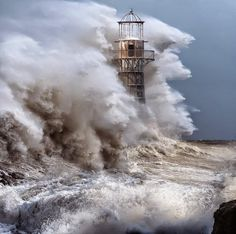 Breathtaking photos of lighthouses battling storms.