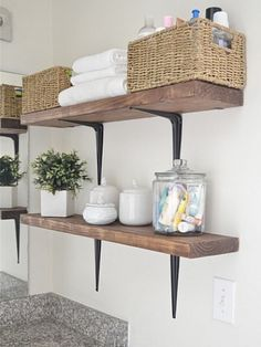 Simple plank shelves on hardware store brackets, you can take above-the-toilet storage all the way to the ceiling!