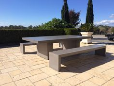 Polished concrete table with matching bench seats by Mitchell Bink Concrete Design. www.mbconcretedesign.com.au