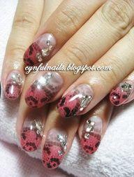 Air brushed nails and rhinestones